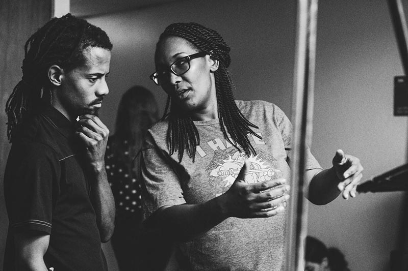 Behind the scenes moment from Boxed (2020), Wanjiru Njendu director