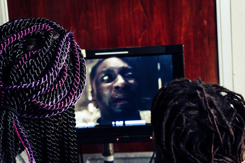 Behind the scenes: Reviewing footage on the monitor on set of Boxed (2020), Wanjiru Njendu director